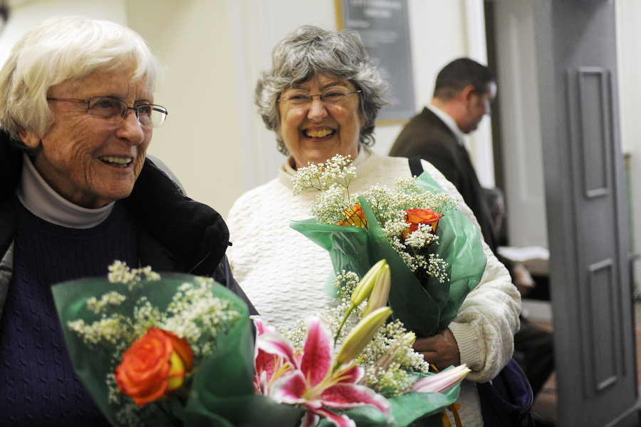 Linda Royster and Barbara Kinsman wait inside the Staunton City Courthouse to apply for their marriage license on Friday, Feb. 14, 2014, in Staunton. Gay couples around the state had planned for about a week to challenge Virginia's official ban on same-sex marriages in an effort organized by People of Faith for Equality in Virginia.