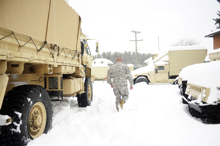 Msg. Doug Buntz walks through the parking lot where the vehicles for the 116th Infantry Brigade Combat Team are parked outside of the National Guard Armory on Thursday, Feb. 13, 2014, in Staunton. The National Guard brigade patrolled the roads on Thursday to help those stranded on the roads and to provide assistance for local first responders.