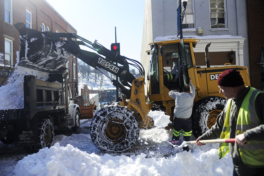 Inmates from Middle River Regional Jail help City of Staunton workers clear Beverley Street of snow downtown on Friday, Feb. 14, 2014, in Staunton.