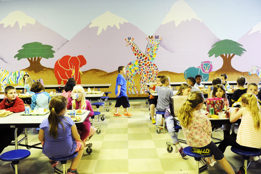 Students eat lunch at Verona Elementary School on Monday, April 14, 2014, in Verona. Schools in Augusta County had their spring break cut short due to snow days, and some are curious about how school attendance will be this week with the change in the school calendar.