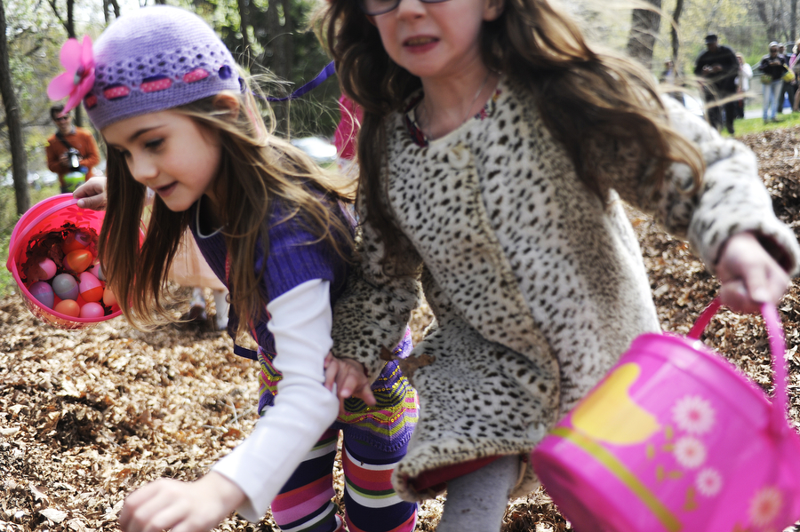 Olivia Delamarter, 7, and Mackenzie Roller, 6, run through the woods to find eggs during the 6 and 7-year old division during the Eggstavaganza Egg Hunt on Saturday, April 19, 2014, at Montgomery Hall Park in Staunton.