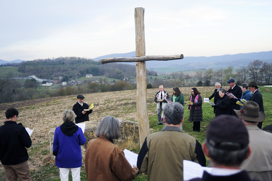 Congregants from the New Providence Presbyterian Church listen to Rev. Keith Cornfield speak as they gather on a hilltop for a sunrise Easter service on Sunday, April 20, 2014, in Brownsburg.