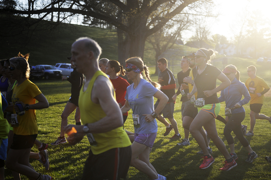 Runners take off at the beginning of the Park to Park half marathon on the morning of Saturday, April 26, 2014, at Ridgeview Park in Waynesboro. The race went from Ridgeview Park to Stuarts Draft Park.