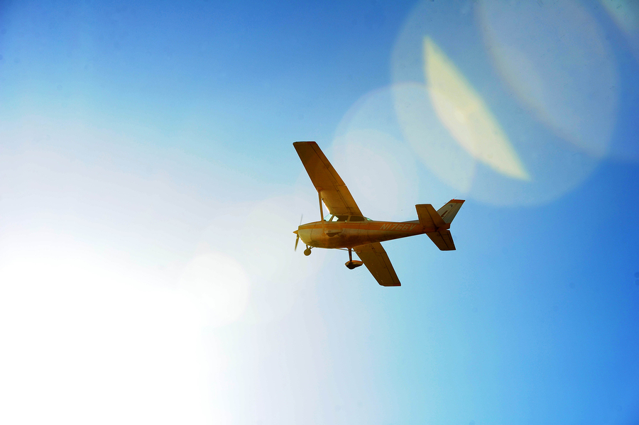 A plane flies overhead at Eagle's Nest Airport on Saturday, April 6, 2013, in Waynesboro.