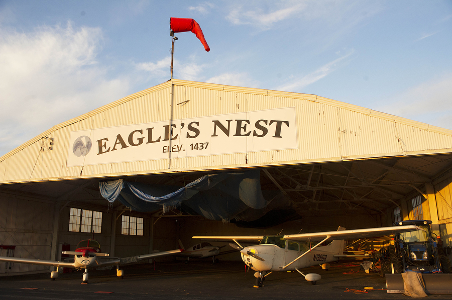 The sun rises on the main maintenance hangar on April 7, 2013, at Eagle's Nest Airport in Waynesboro.
