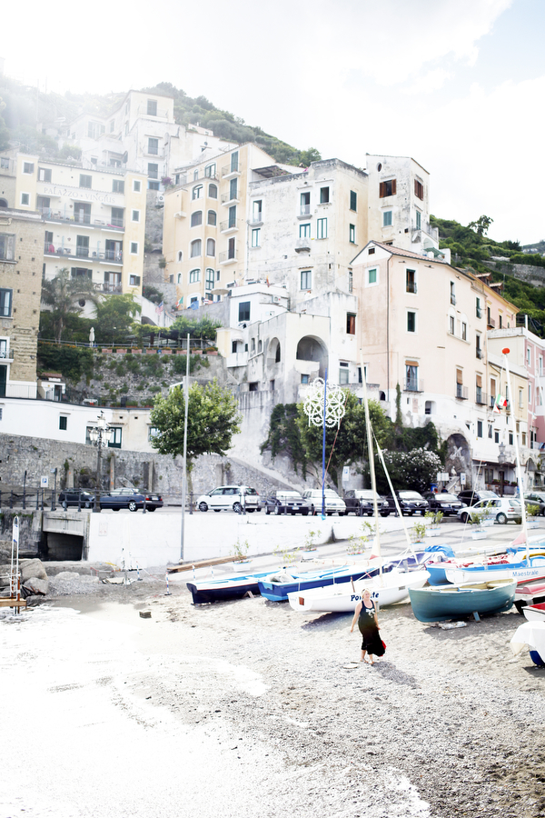 A woman walks on the beach in Minori on Wednesday, July 9, 2014, on the Amalfi Coast.