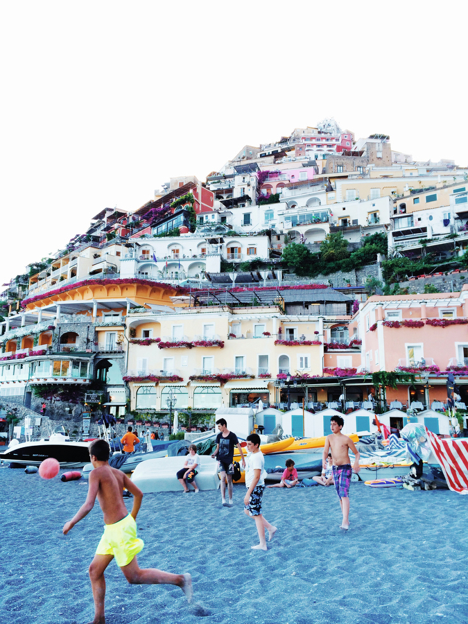 Children play soccer in the sand on the beach in Positano, Italy.