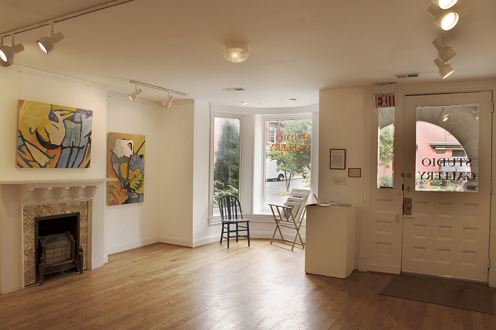 Upstairs Exhibition Space with Colorful Paintings