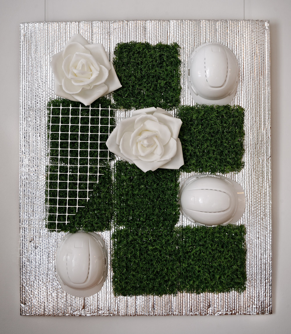 """Green Construction   Aluminum, Insulation, Faux flower and grass, Helmet  39"""" x 40""""  $2,600  Click to enlarge   Inquire."""