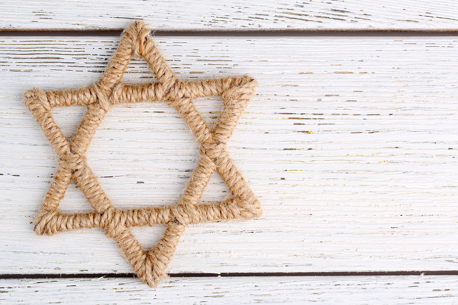 bigstock-Star-of-David-on-wooden-backgr-71044888.jpg