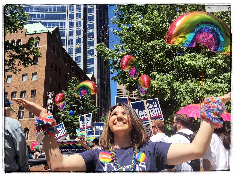 Miranda Roberts, political director for Lt. Governor candidate Cyrus Habib throws glitter into the air. PHOTOS: Tara Nelson