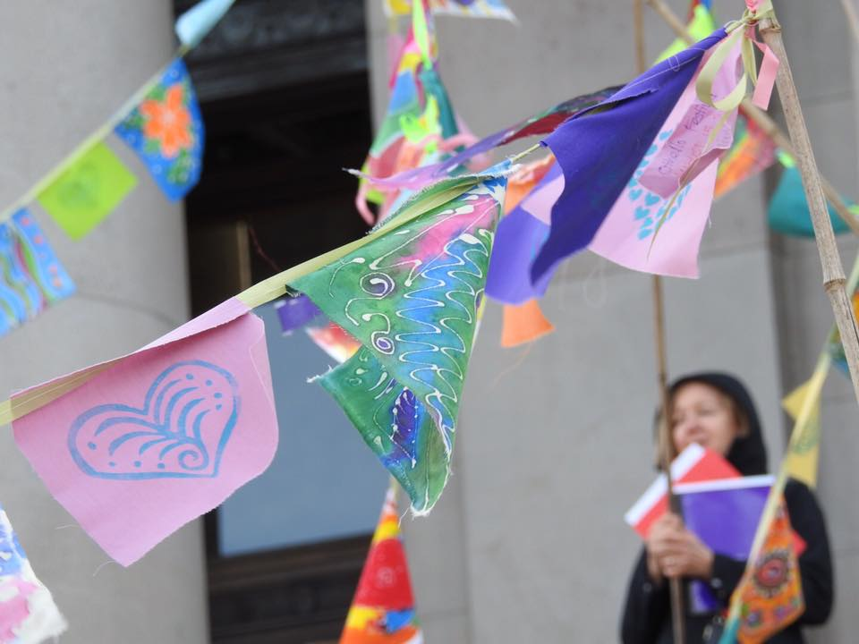 Prayer flags fly during a rally for low-income housing and homeless issues at the Washington State Capitol building Thursday, Feb. 2 in Olympia. The flags were made by homeless individuals who had been left on the street when cold-weather shelters were full. Photo: Tara Nelson.