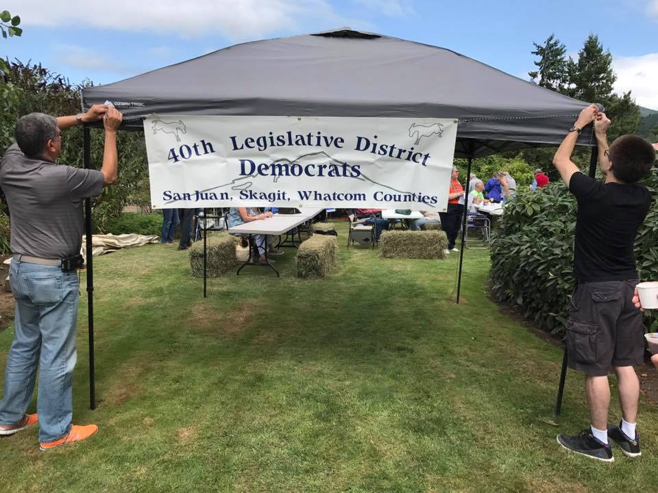 Mt. Vernon City Council candidate Jorge Manzanera and former 40th Democrats Vice Chair Dylan Richardson help set up our banner.