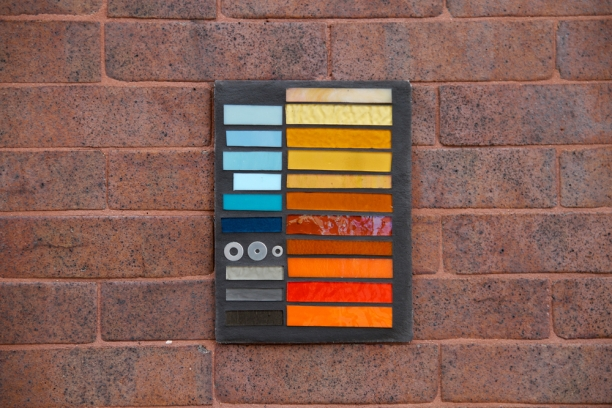 glass palette on brick wall at 5553 N Clark