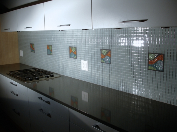 Hancock kitchen | animated abstract insets with glass tile surround c Heather Hancock