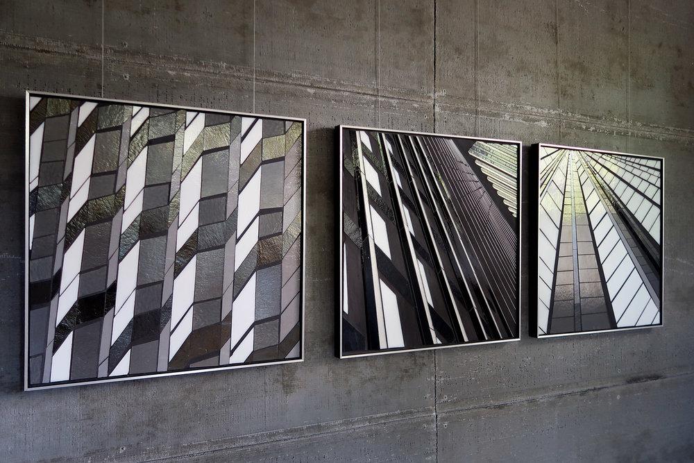 "Reflect 1.40 waves | Reflect 1.15 city view | Reflect 1.16 urban mountain | each 24"" x 24"" | glass  c Heather Hancock 2018"