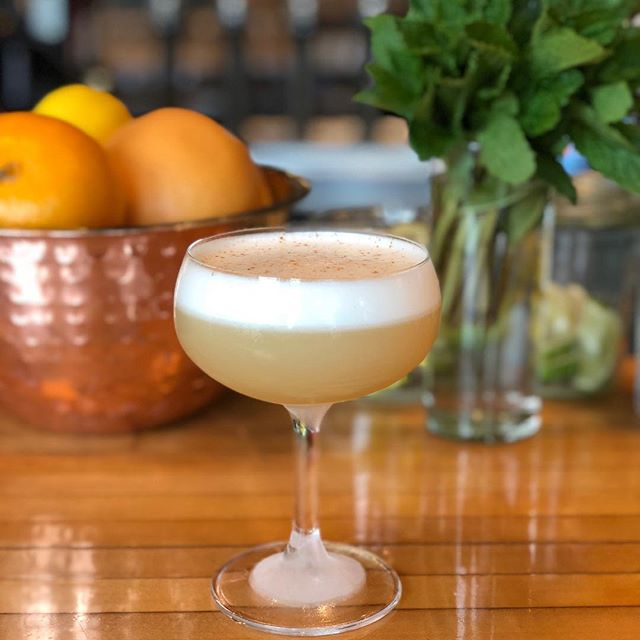 Our rainy day fix? Two Lanterns. Our spiced rum, egg white cocktail topped with cinnamon.  #stamford #stamfordct #stamfordcocktails #harborpoint #harborpointstamford #cocktails #eggwhitecocktail #craftcocktails #happyhour