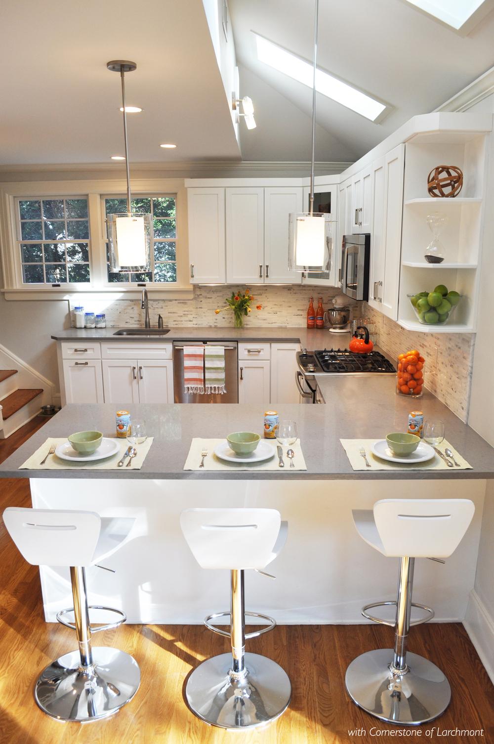KAM DESIGN LLC_Kitchen Remodel_White Cabinets_Peninsula_Glass Pendants_Caesarstone.jpg