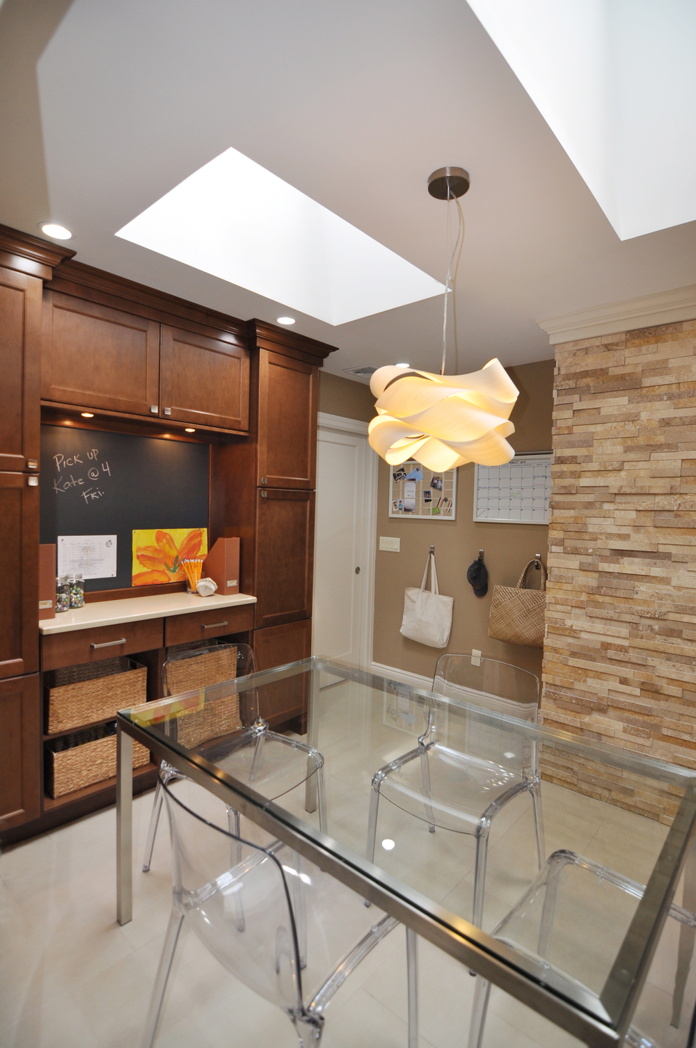 KAM DESIGN LLC_Kitchen Renovation_Interior Design_Cabinets_Stone Wall_Modern Kitchen_Modern Pendant_Acrylic Dining Chairs_Glass Kitchen Table_Kids Organization Area_Storage.jpg