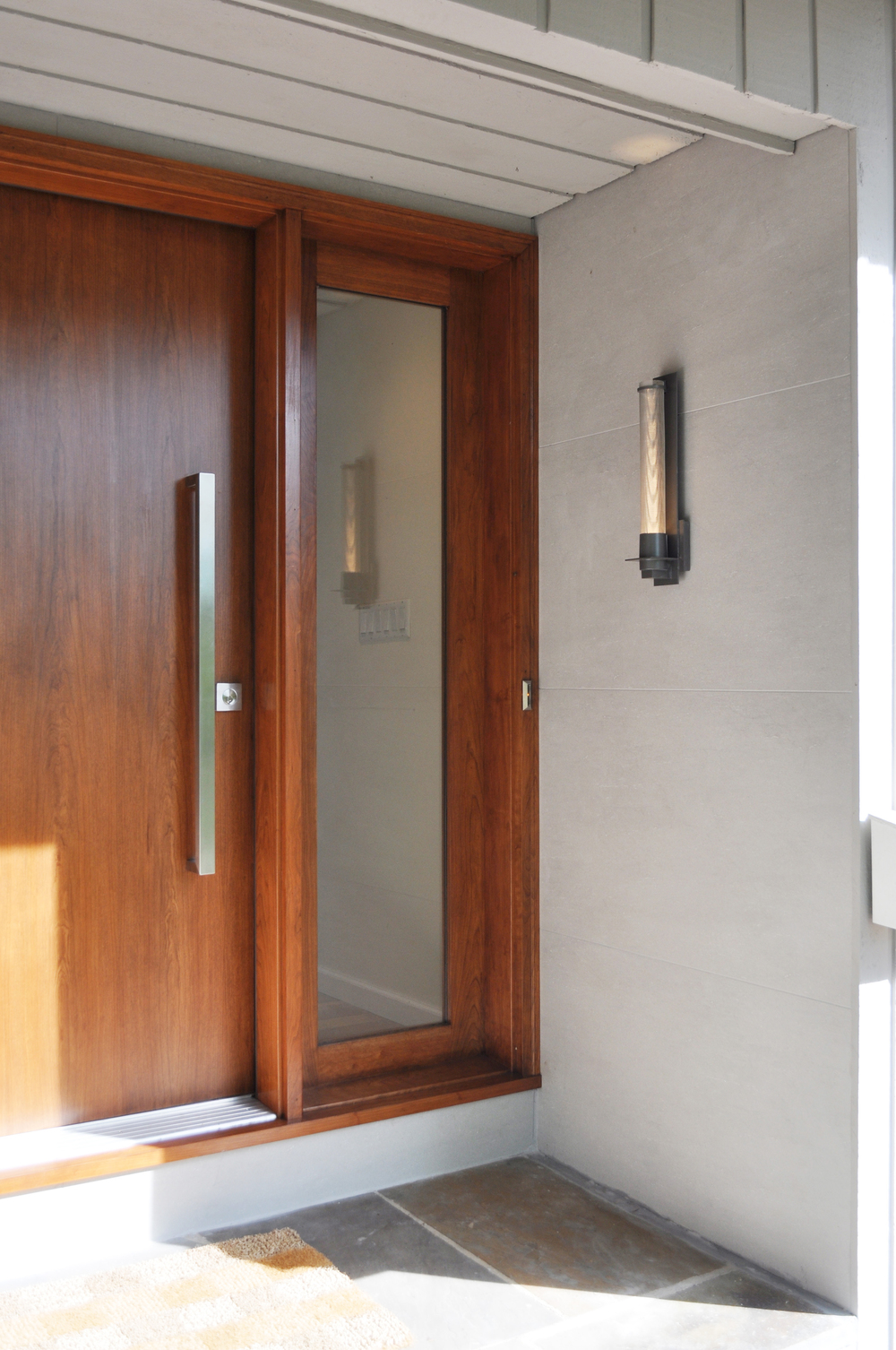 Front Door_Modern Cherry Slab Front Entry Door_Stainless Hardware_Hubbardton Forge Sconce_Porcelain Wall Tile_KAM DESIGN.jpg