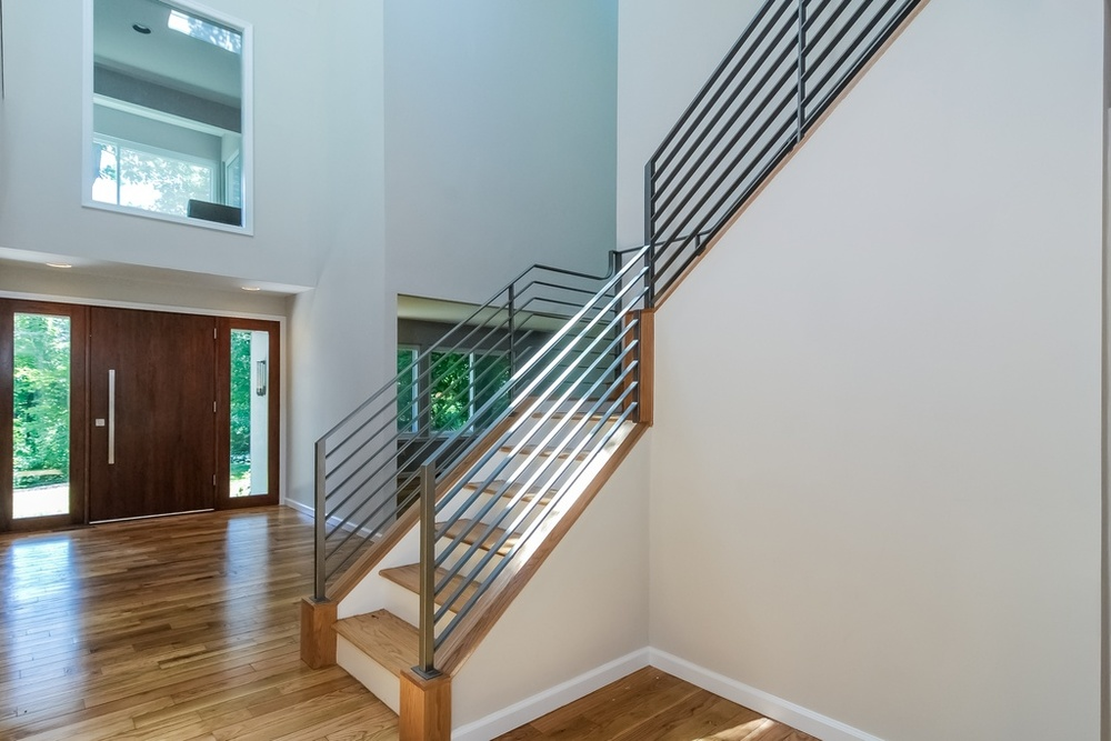 Foyer Iron Stair Railing_Front Door_KAM DESIGN.jpg