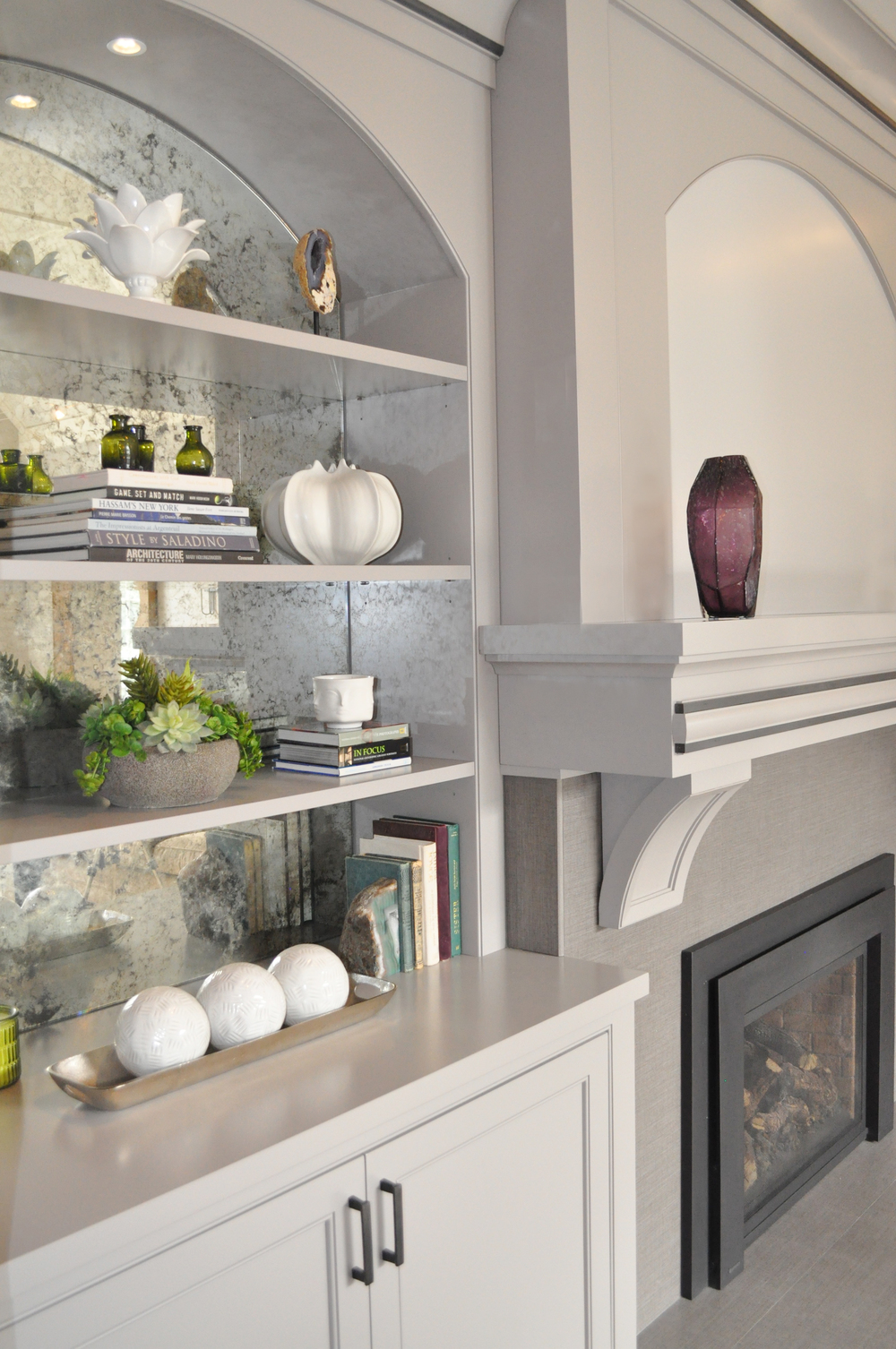 KAM DESIGN_Interior Designer Kim A Mitchell_Larchmont NY Family Room_Custom Gray Shelving with Antique Mirror Back_Custom Overmantel_2016.jpg