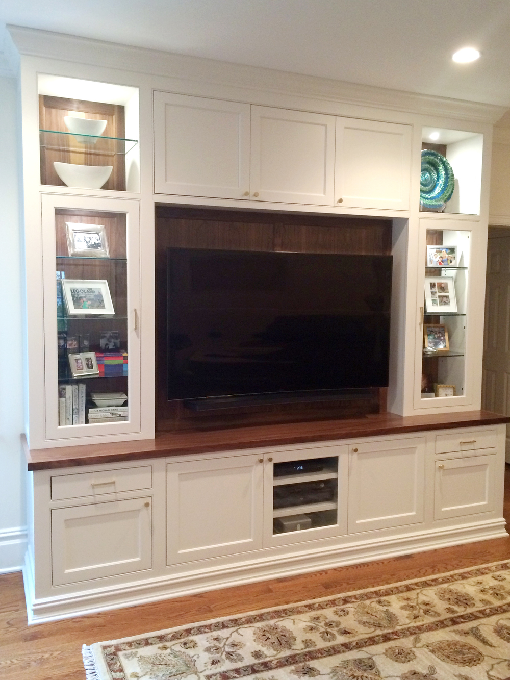 KAM DESIGN_Custom Millwork_White Painted_Walnut Top_Walnut Back Panels_Glass Cabinets_Pin Lights_Scarsdale NY Family Room_2016_web.jpg