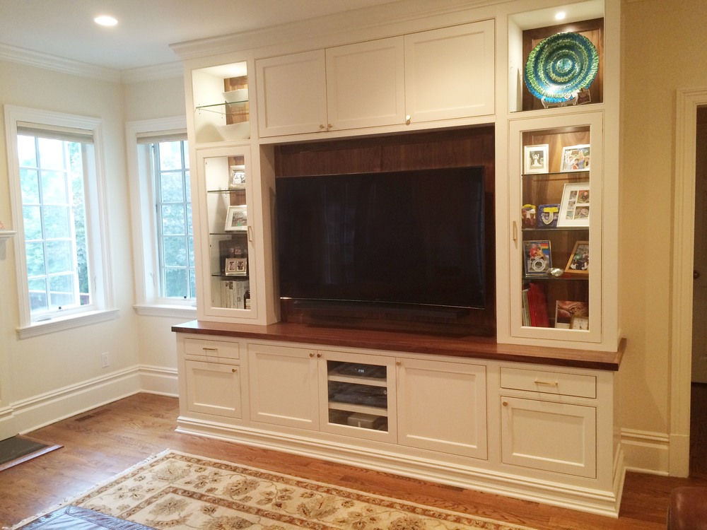 KAM DESIGN_Custom Millwork_White Painted_Walnut Top_Walnut Back Panels_Glass Cabinets_Pin Lights_Scarsdale NY Family Room_2016_webangle.jpg