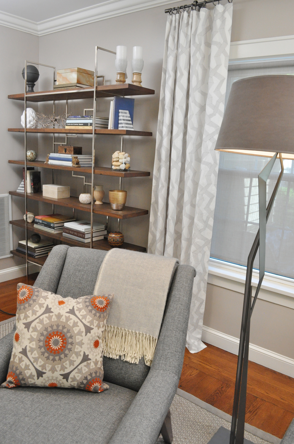 Kim A Mitchell_Design Lead_HGTV_Buying and Selling with The Property Brothers_Season 5_Episode 8_Living Room After_Hubbardton Forge Lamp_FoundryWood Shelving_Kontrast_Throw_8_31_2016 Airdate.jpg