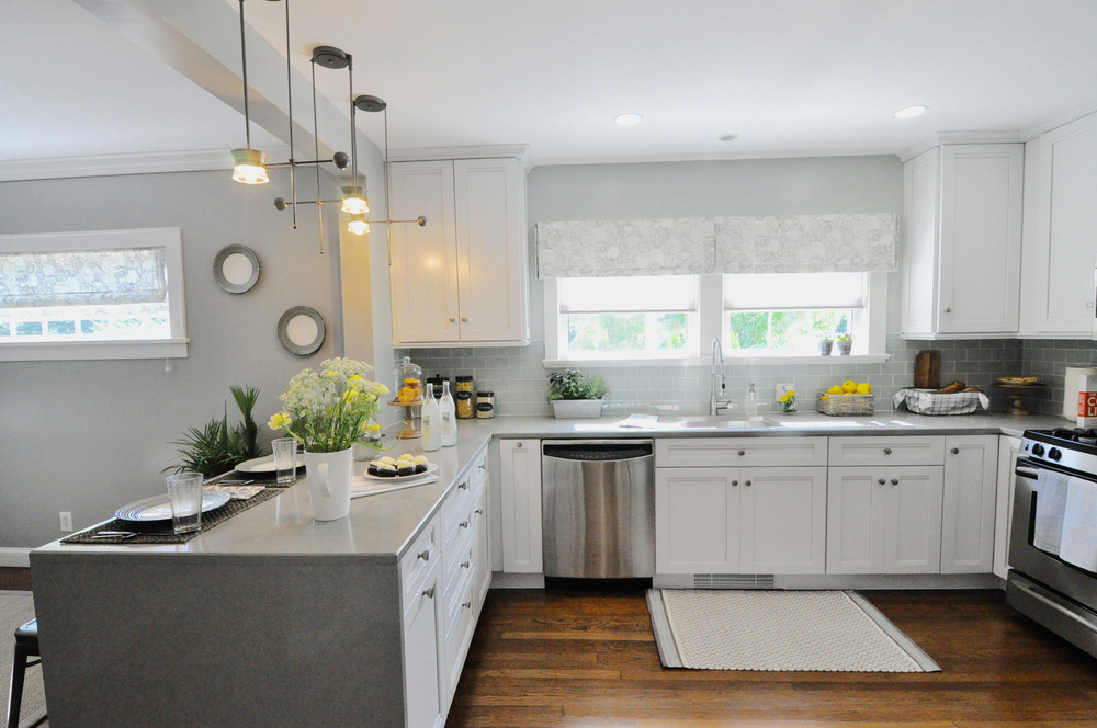 Kim Mitchell Design Lead_HGTV_Buying and Selling with The Property Brothers_Season 5_Episode 8_Kitchen Remodel_Sink_Peninsula_Modern Industrial Kitchen_Grey Kitchen_8_31_2016 airdate.jpg