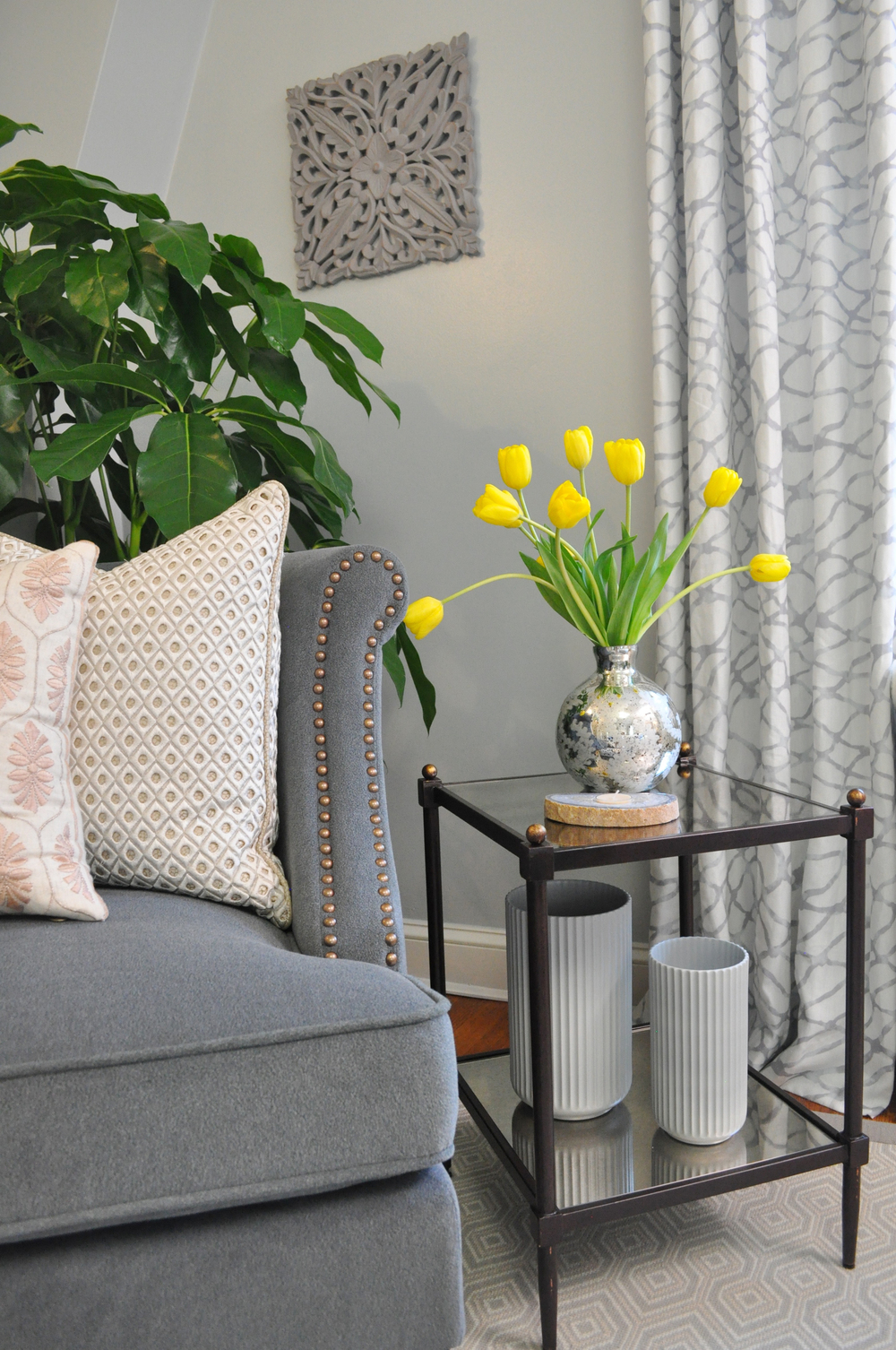 Kim Mitchell Design Lead_HGTV_Buying and Selling with The Property Brothers_Season 5_Episode 8_Bedroom_Side Table_Chair_Tulips_Kontrast Vases_8_31_2016.jpg