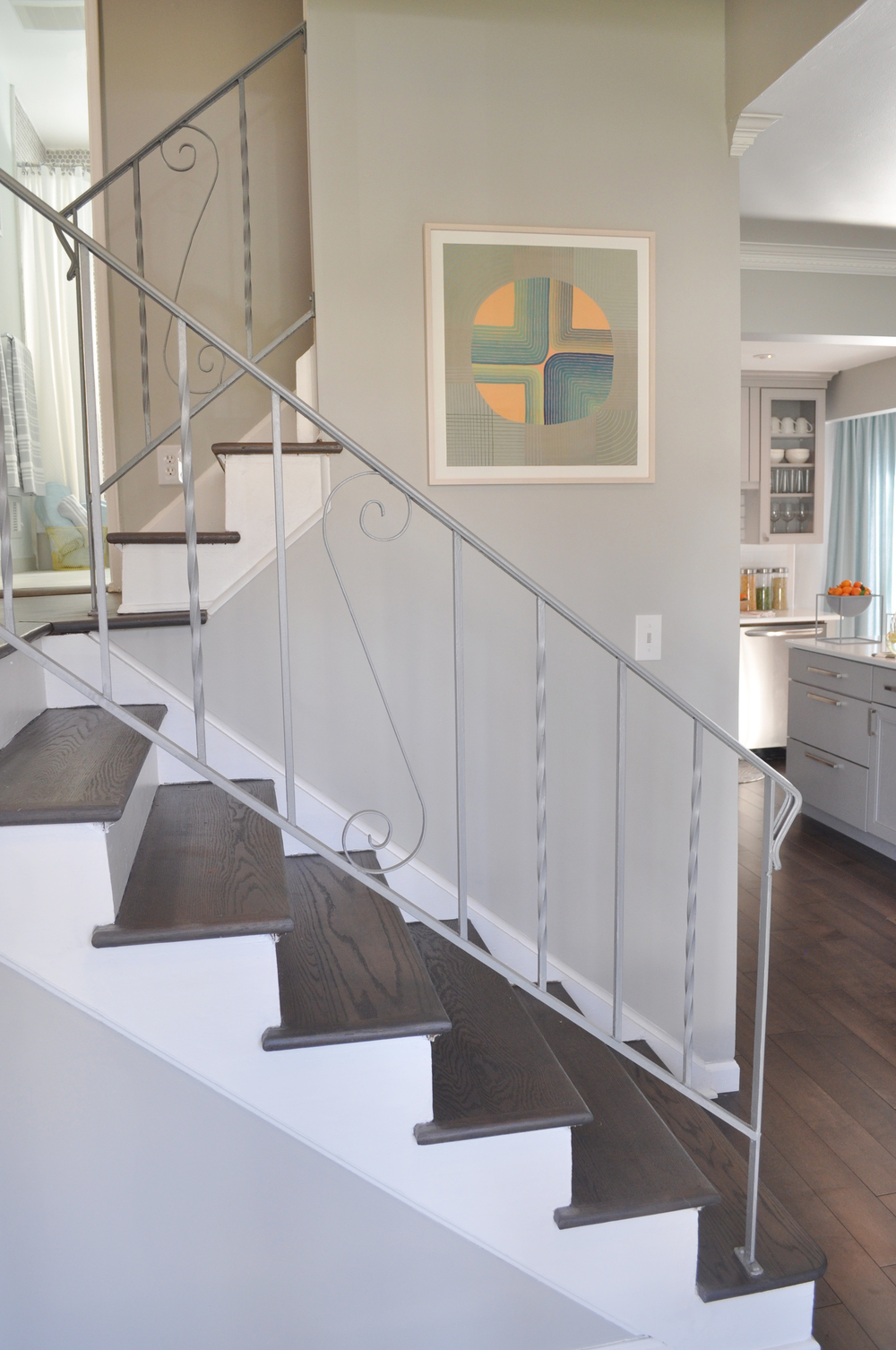 Kim Annick Mitchell Production Designer_HGTV_Buying and Seling with The Property Brothers_Season 3_Episode 316_Gray Entry Staircase_Modern Art.jpg