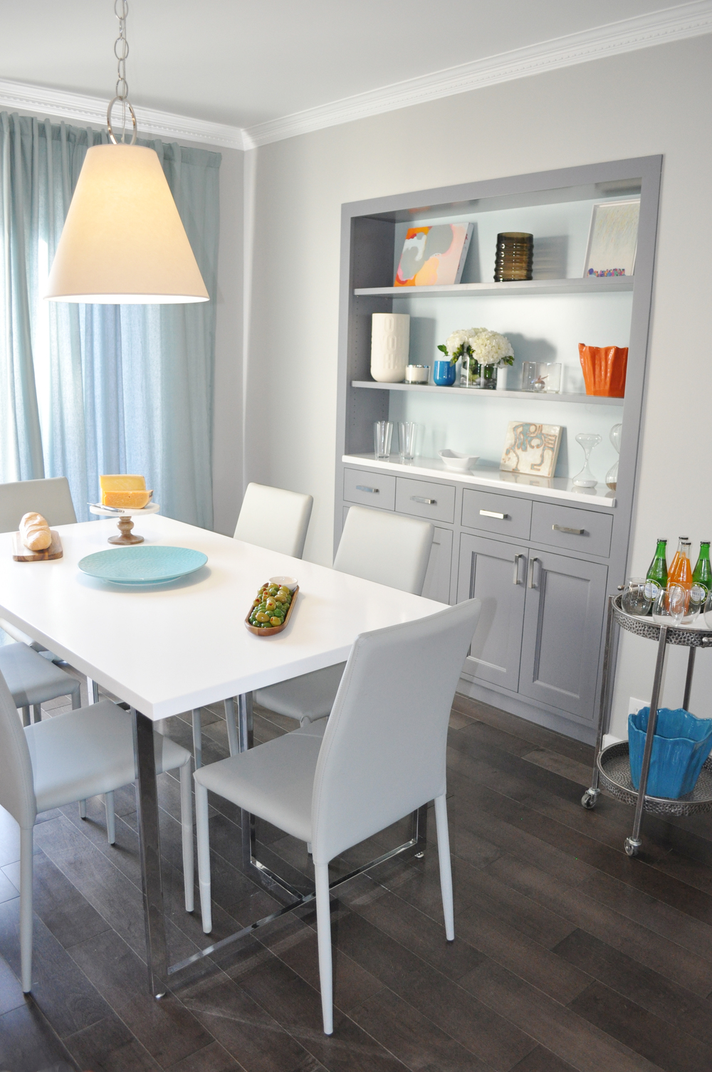 Kim Mitchell Production Designer_HGTV_Buying and Selling with The Property Brothers_Season 3_Episode 316_Dining Room Design_Dining Room Cabinetry_Kitchen Table Pendant Light_Grey Wood Flooring_Kenise Barnes Gallery Art_Grey Cabinets.jpg