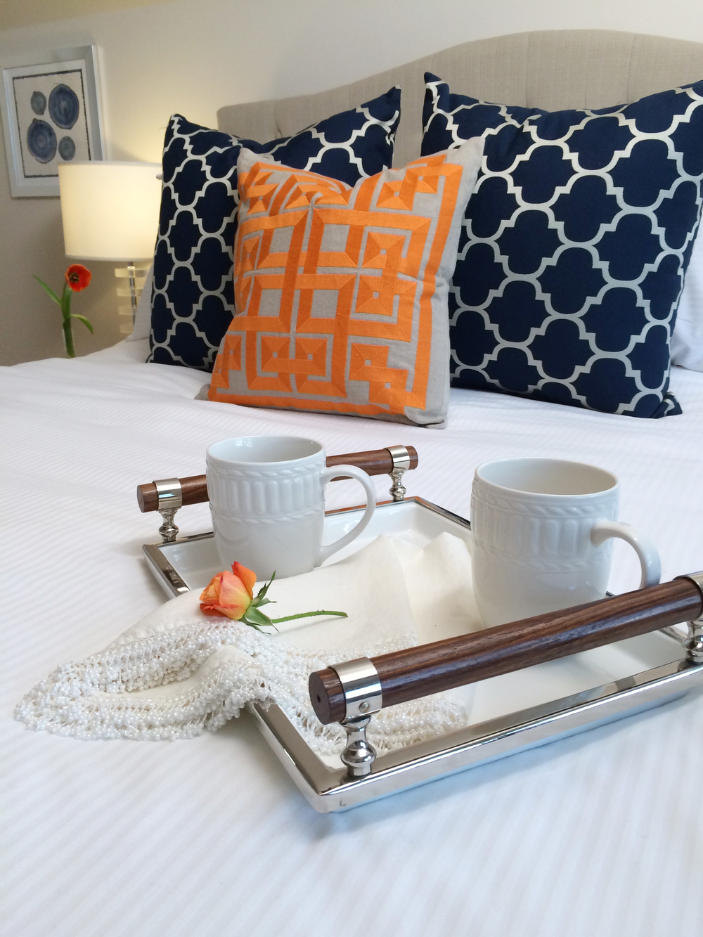 Kim Mitchell_Production Designer_HGTV_Buying and Selling with The Property Brothers_Season 3_Episode 316_MasterBedroom_Navy_Orange_Close-up Bedding.jpg
