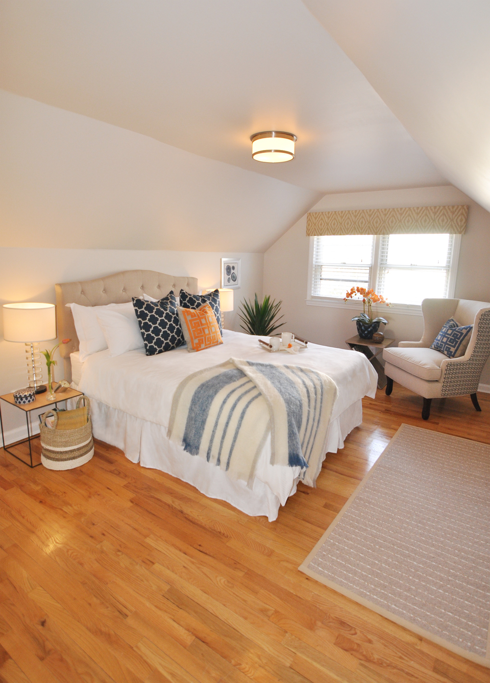 Kim Mitchell_Production Designer_HGTV_Buying and Selling with The Property Brothers_Season 3_Episode 316_Master Bedroom_Navy_Orange_Scandecor Rug_Kontrast Throw Side Table.jpg
