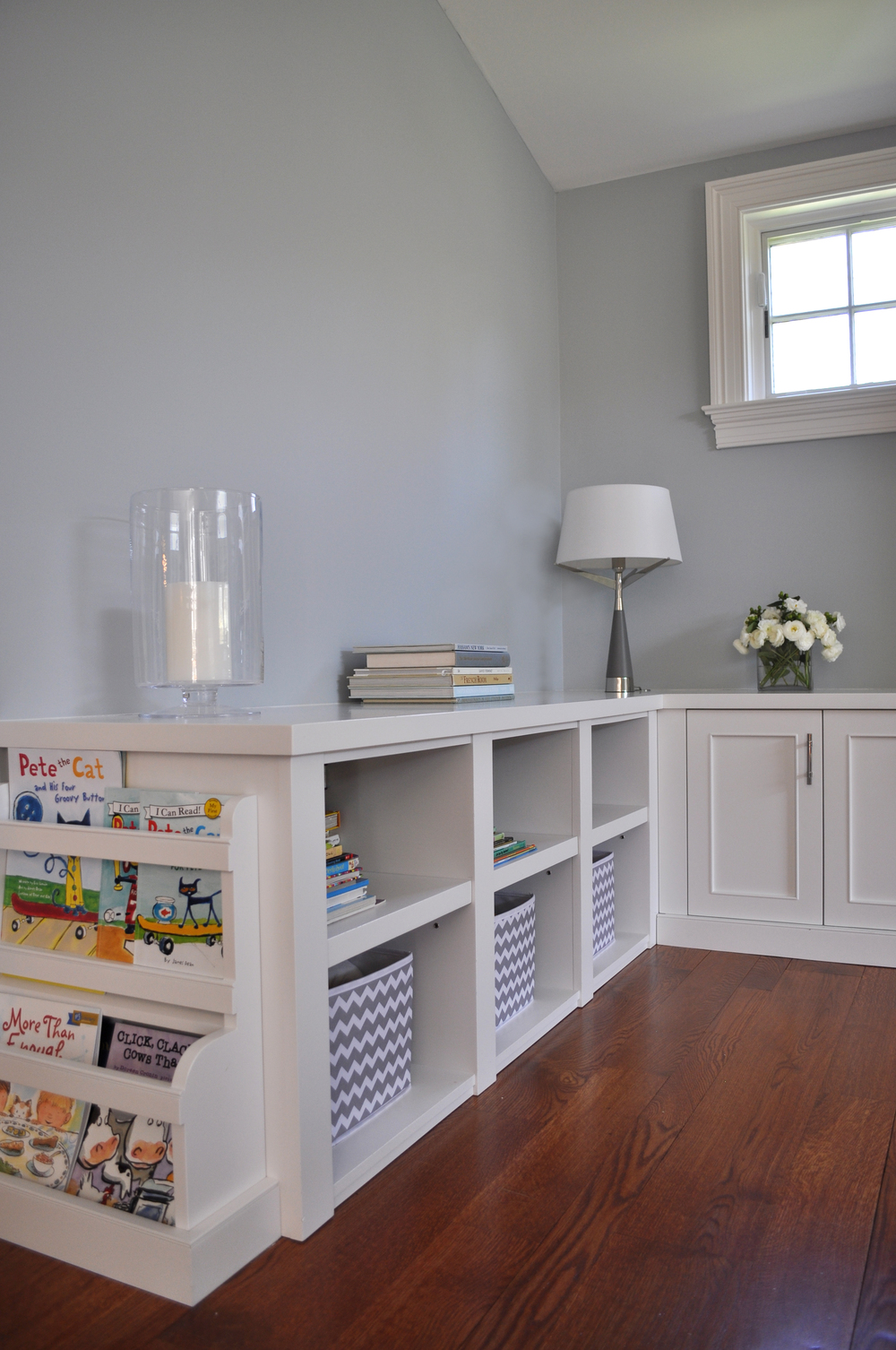 KAM DESIGN_Interior Designer Kim A Mitchell_Transitional Family Room_Gray_Light Blue_Warm Accents__Mamaroneck NY_Custom White Painted Storage Unit_Kids Book Storage End Unit_2016_for Web.jpg