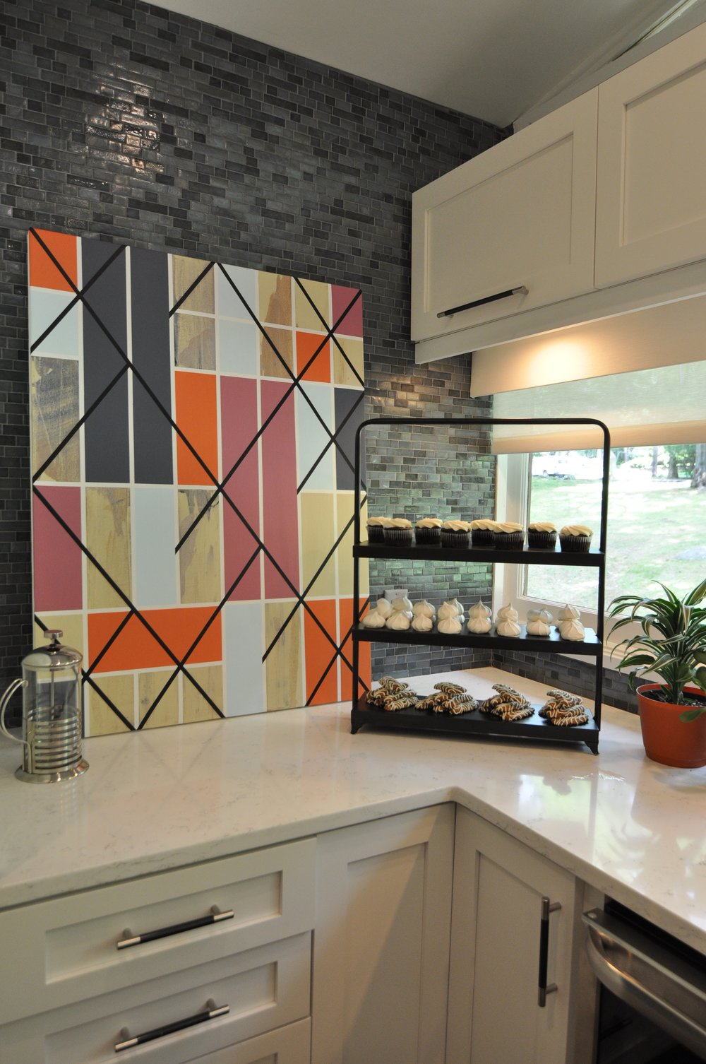 Kim A Mitchell_Design Lead_HGTV_The Property Brothers_Season 6_Episode 9_Close-up Glass Tile Backsplash_Art_Staging_2017.jpg