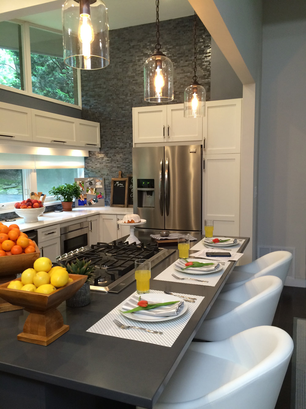 Kim A Mitchell_Design Lead_HGTV_The Property Brothers_Season 6_Episode 9_Kitchen_Blue Glass Tile Backsplash_Emtek Hardware_Glass Pendants_Modern Kitchen_2017.jpg
