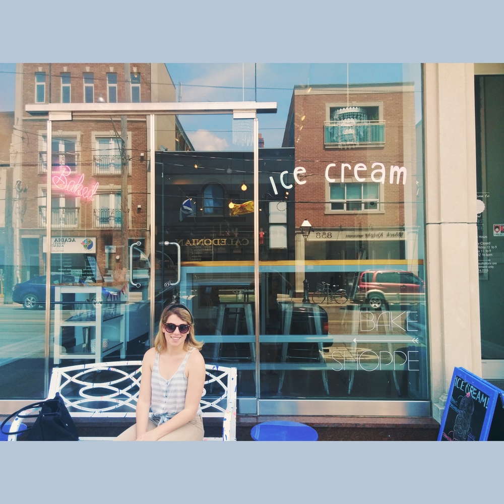 Carly sitting pretty in front of the Bake Shoppe. Love the type on the window!