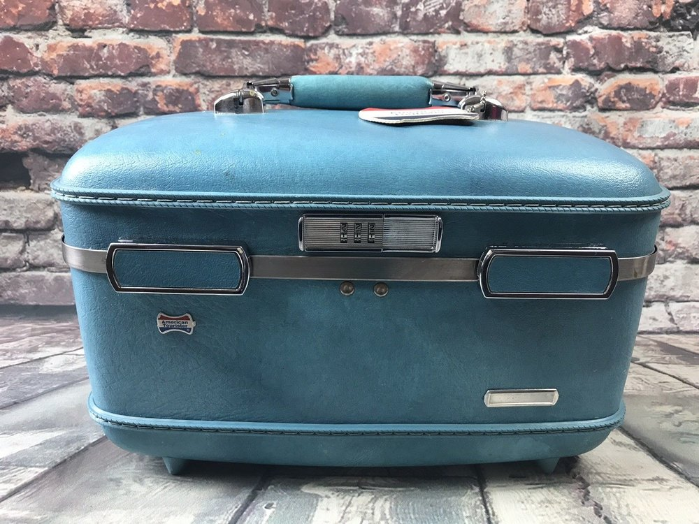 blue american tourister train case.jpg