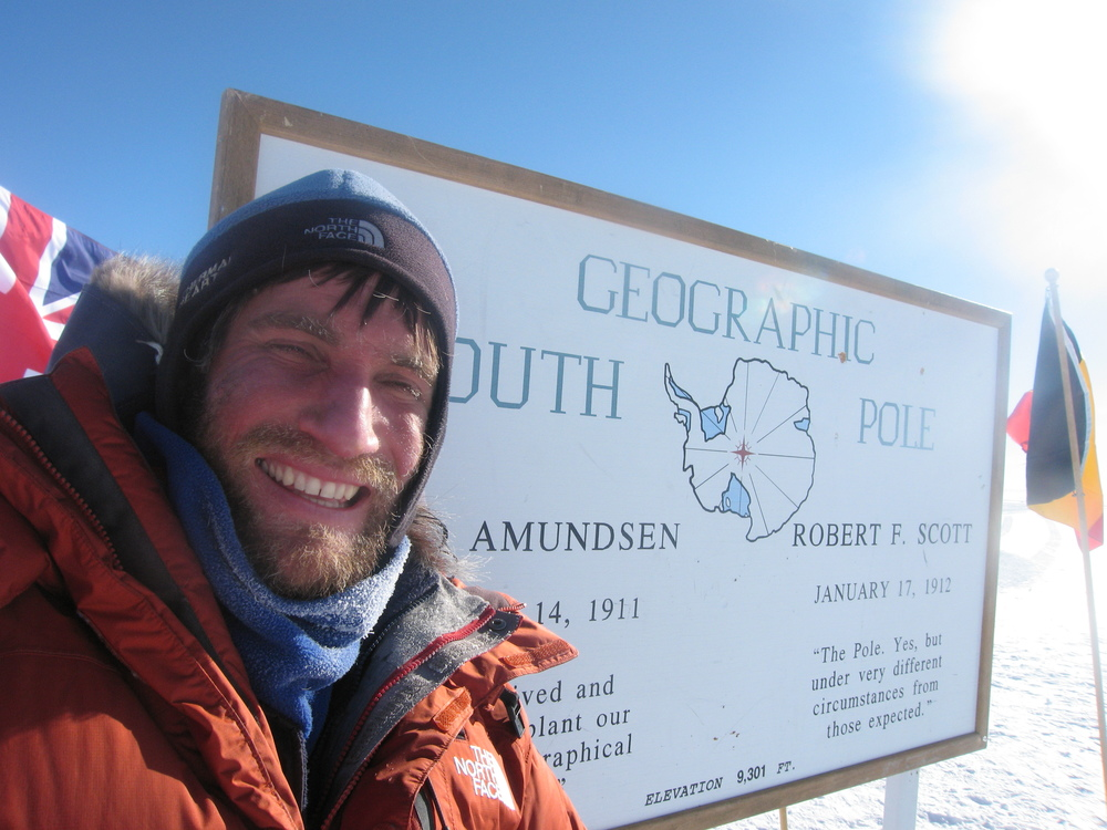 Kevin Biggar at Geographic South Pole and sign that proves it.jpg
