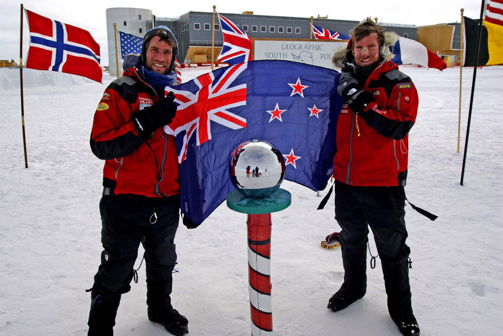 Kevin Biggar with Jamie Fitzgerald at South Pole with flag.jpg