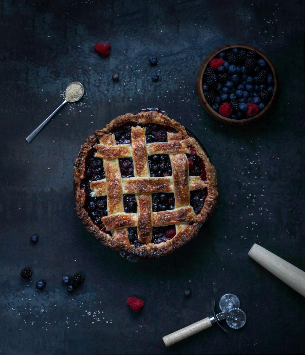 Bumbleberry Pie || Three types of berry pie (raspberry, blackberry + blueberry). Homemade pie crust from scratch with an easy to make pie filling. A perfect summer pie for a picnic or potluck. || creamandhoney.ca