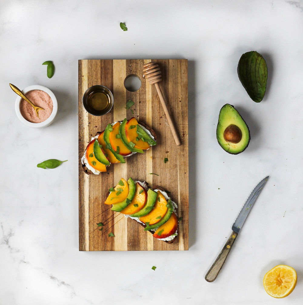 Peach Avocado + Lemon Goat Cheese Toast || Crusty toast topped with whipped lemon goat cheese, fresh basil, peaches, avocado + honey. A perfect summer breakfast, lunch or snack. Elegant with only a handful of ingredients. || creamandhoney.ca
