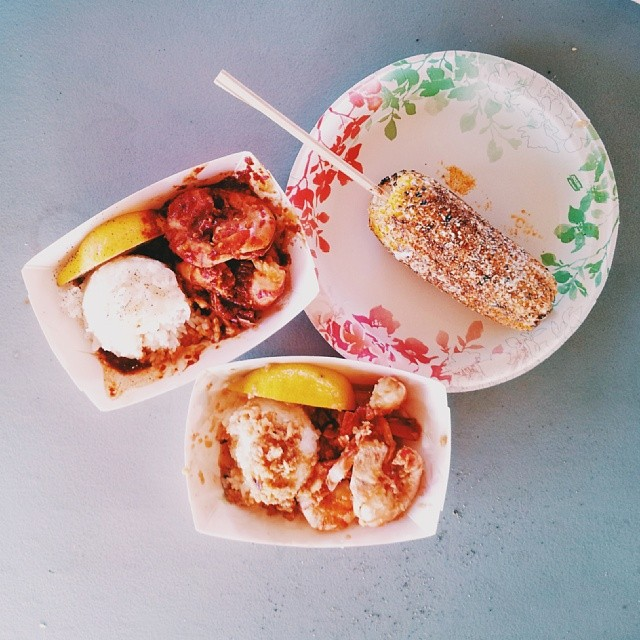 Midday, you devour a seafood  plate lunch  + Mexican corn from a food truck on the coast.
