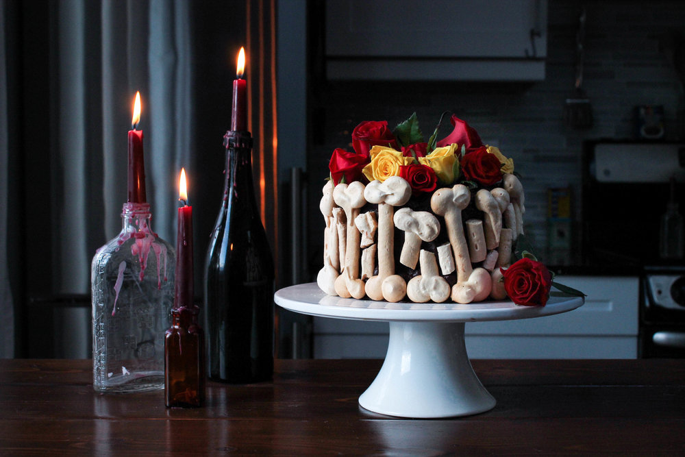 Chocolate + Salted Dulce De Leche Graveyard Cake w/ Meringue Bones || A decadent layer cake for Halloween. Rich moist chocolate cake layered with salted caramel, dark chocolate frosting and meringue bones for decoration.  || creamandhoney.ca