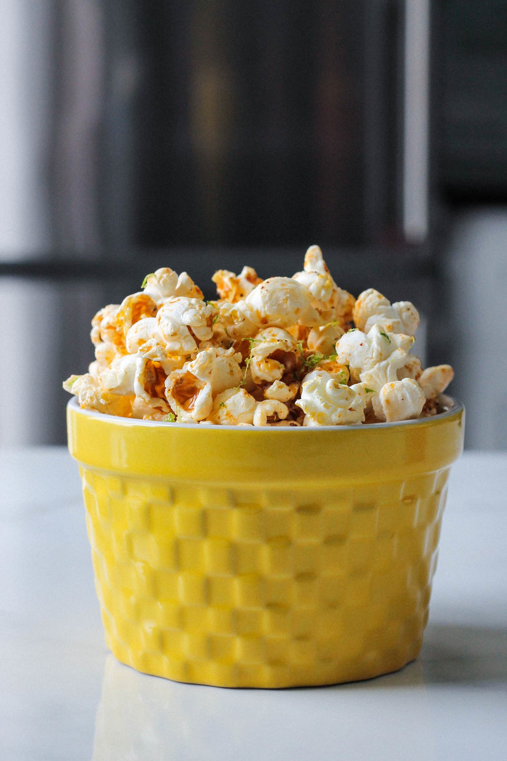 Mexican Spiced Lime Popcorn || Popcorn Three Ways (Vegan) || Healthy + delicious recipes for 3 popcorn flavours without butter– classic, mexican spiced lime, and ras el hanout with salted maple. All plant based, dairy free, gluten free and easy to make! || www.creamandhoney.ca