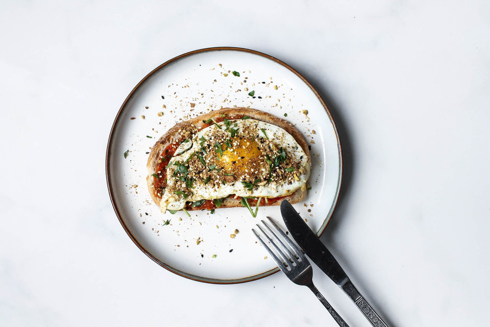 Charred Ajvar, Egg + Dukkah Toast || This charred eggplant + red pepper spread is healthy, vegan and delicious. Serve it on toast with arugula, an egg and dukkah for any meal of the day!  || creamandhoney.ca
