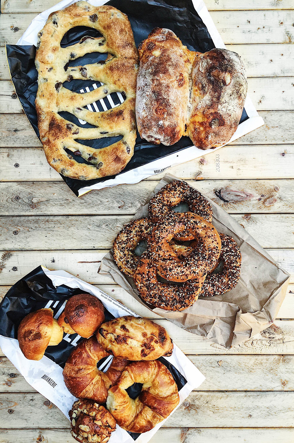 "olive fougasse (top left), potato cheddar bread, everything bagels from Fairmount Bagel, white chocolate brioche ""mushrooms"", chocolate l'ecolier, butter croissants, and and almond frangipane croissant."