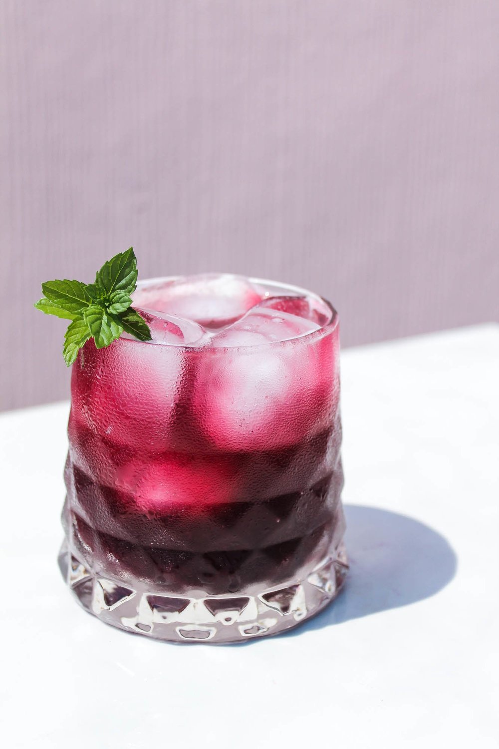 Blueberry Lemon Mint Soda || Refreshing summer mocktail recipe made with blueberries, lemon juice, honey, sparkling water + fresh mint. No refined sugars and tastes amazing as a gin or vodka cocktail. || creamandhoney.ca